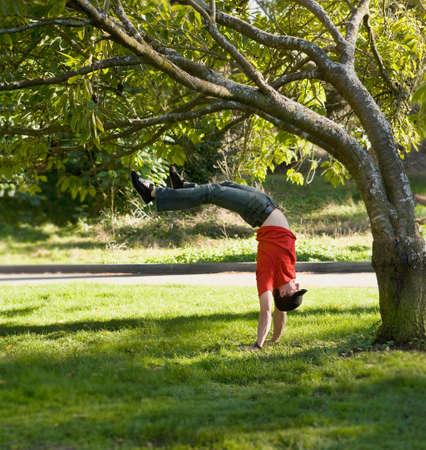 handstand: Hispanic man doing handstand outdoors