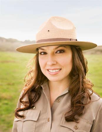bathtowel: Hispanic female park ranger in field