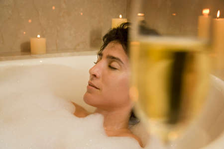 woman in bath: Woman relaxing in bubble bath LANG_EVOIMAGES
