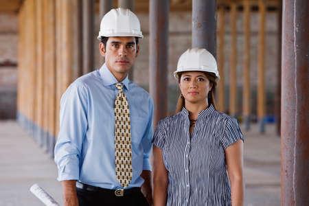 pacific islander ethnicity: Multi-ethnic businesspeople wearing hard hats