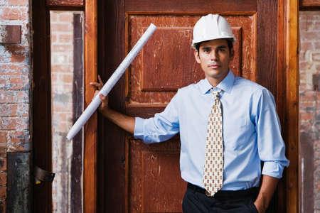 hard hat: Hispanic businessman wearing hard hat LANG_EVOIMAGES