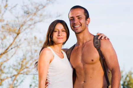 exerting: Hispanic couple hugging