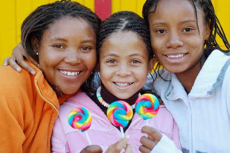 one teenage girl only: Multi-ethnic girls holding lollipops