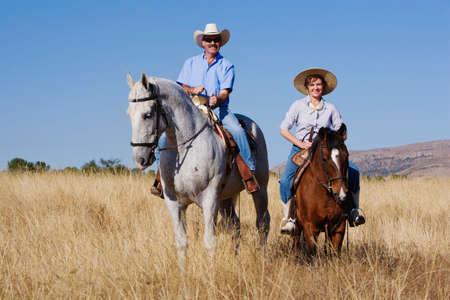 full length herbivore: Hispanic couple riding horses