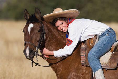 indignant: Hispanic woman hugging horse LANG_EVOIMAGES