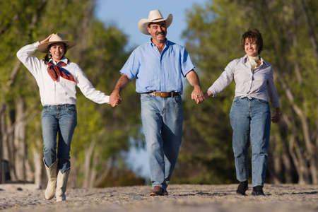 full length herbivore: Hispanic family holding hands