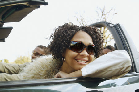 african american couple: African couple driving in convertible car LANG_EVOIMAGES