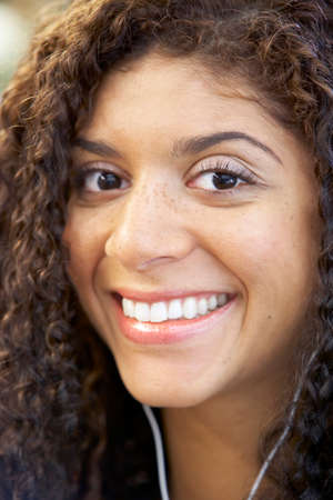 Close up of Mixed Race woman wearing headphones
