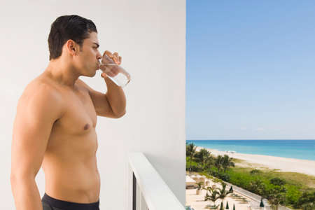 ostentatious: Bare-chested Hispanic man drinking water