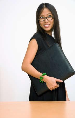 guarding: Asian businesswoman holding portfolio