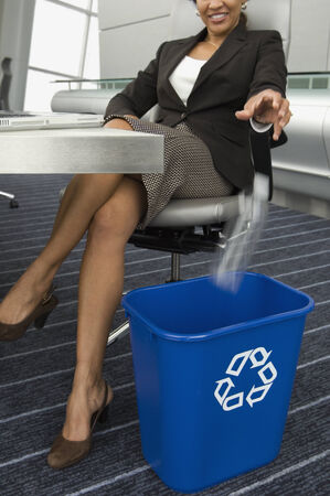 hankerchief: Hispanic businesswoman recycling bottle LANG_EVOIMAGES