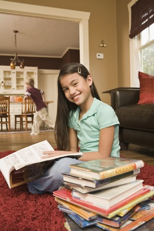 saturating: Pacific Islander girl reading library book