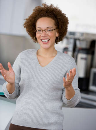 tugging: African businesswoman gesturing LANG_EVOIMAGES
