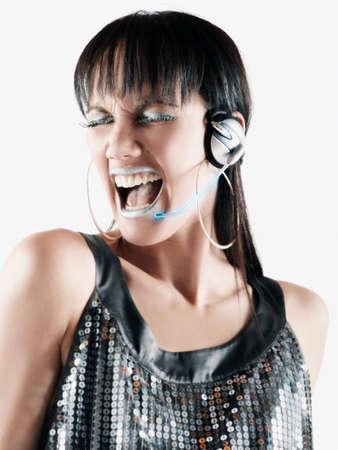 islander: Pacific Islander woman listening to headphones LANG_EVOIMAGES