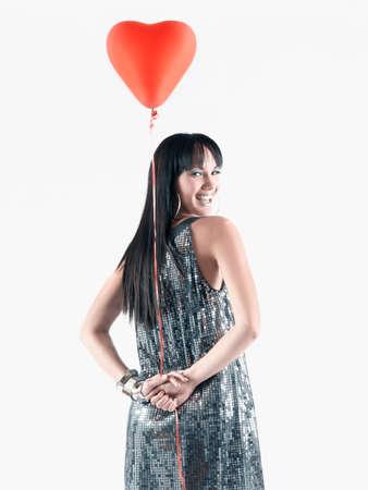 pacific islander ethnicity: Pacific Islander woman holding heart-shaped balloon