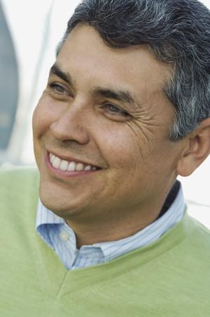 acknowledging: Hispanic man looking to side LANG_EVOIMAGES