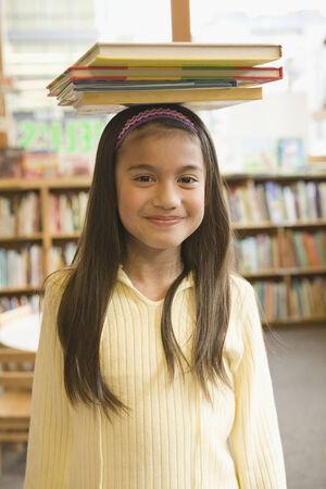 islander: Pacific Islander girl balancing library books on head