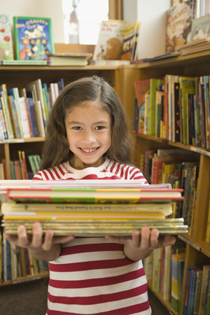 pacific islander: Pacific Islander girl holding library books