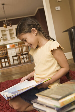 Pacific Islander girl reading library book