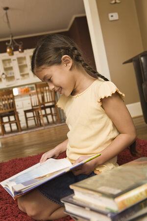 pacific islander: Pacific Islander girl reading library book