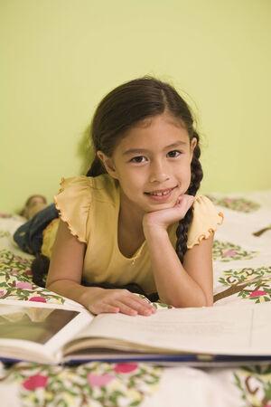 coverlet: Pacific Islander girl reading book