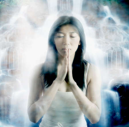 motioning: Asian woman praying LANG_EVOIMAGES