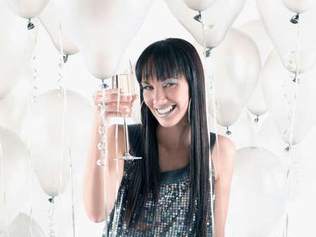 pacific islander ethnicity: Pacific Islander woman drinking champagne