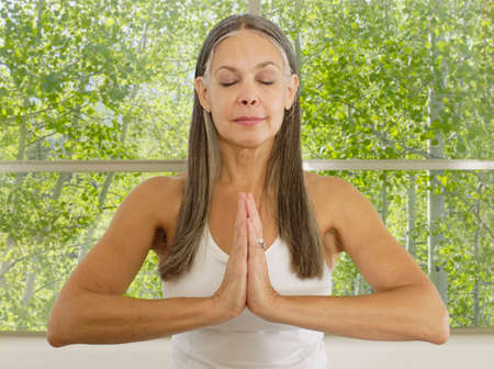 practicing: Asian woman practicing yoga