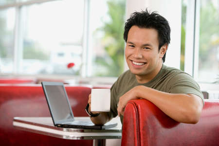 wooing: Asian man sitting in diner booth