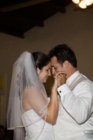 typist: Hispanic bride and groom dancing