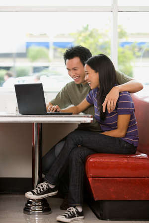 pacific islander ethnicity: Asian couple looking at laptop