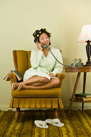 acknowledging: Asian woman in curlers talking on telephone