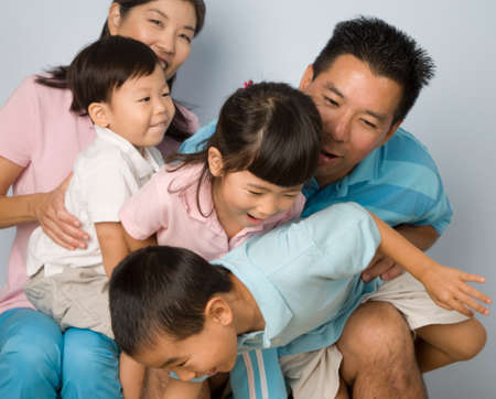 age 40 45 years: Asian family being silly LANG_EVOIMAGES