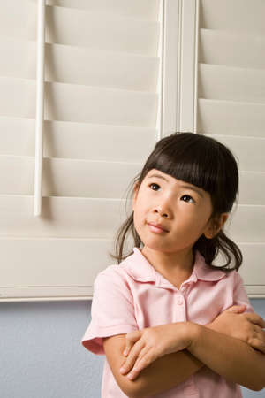 fathering: Asian girl with arms crossed