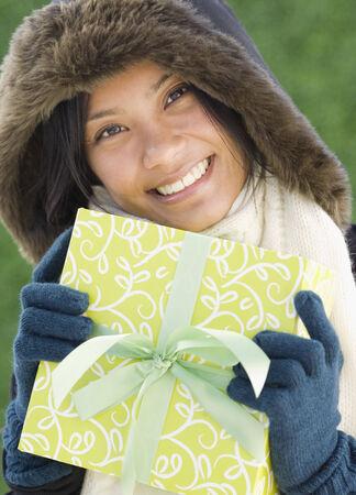 islander: Pacific Islander woman holding gift