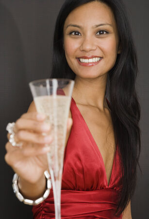 islander: Pacific Islander woman holding champagne LANG_EVOIMAGES