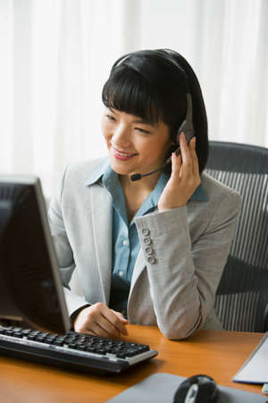 hands free device: Asian businesswoman wearing headset