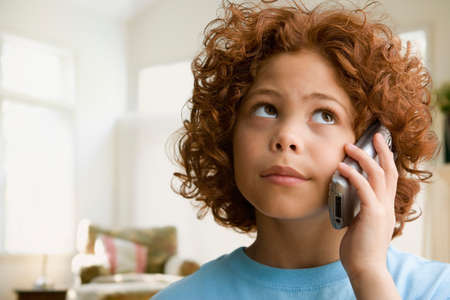 acknowledging: Mixed Race boy talking on cell phone