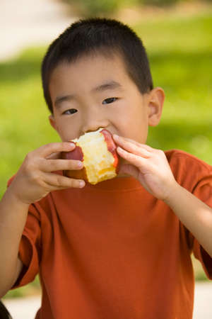 age 40 45 years: Asian boy eating apple