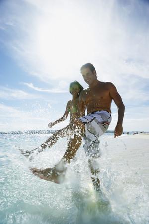 unconcerned: Hispanic couple splashing water