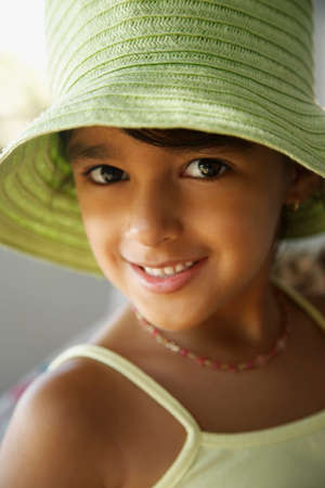 facing away: Hispanic girl wearing hat