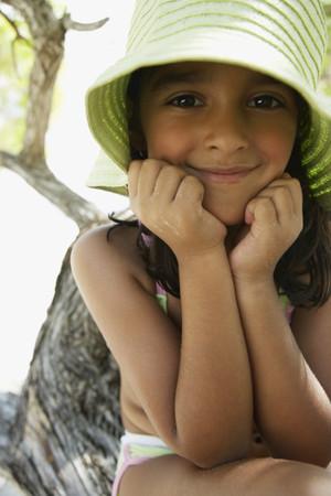 bathingsuit: Hispanic girl wearing hat at beach