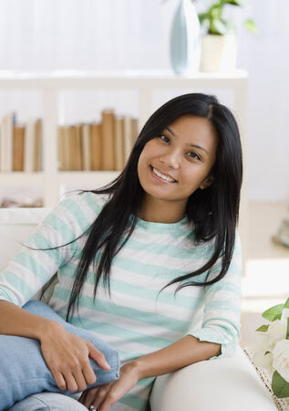 islander: Pacific Islander woman sitting on sofa