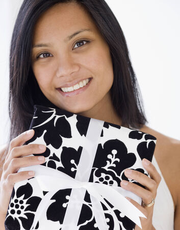 unwholesome: Pacific Islander woman holding gift