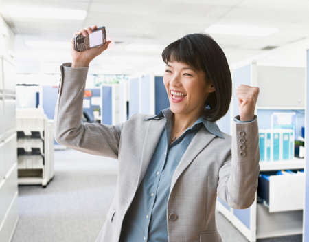 seriousness skill: Asian businesswoman cheering