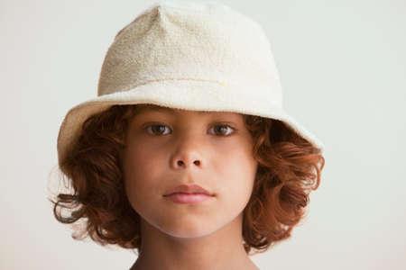 barring: Mixed Race boy wearing hat