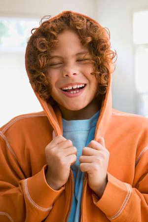 hooded sweatshirt: Mixed Race boy wearing hooded sweatshirt LANG_EVOIMAGES