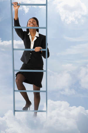 ladder: African businesswoman climbing ladder in clouds LANG_EVOIMAGES
