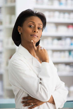 scaling ladder: African female pharmacist with finger on chin