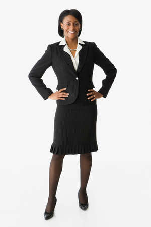 interrogating: African businesswoman with hands on hips